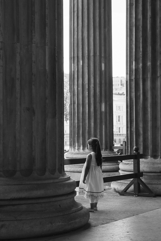 Little girl and ancient columns